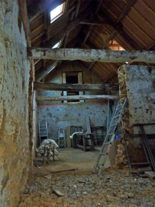 Photo of the interior of the barn at the start of the renovation