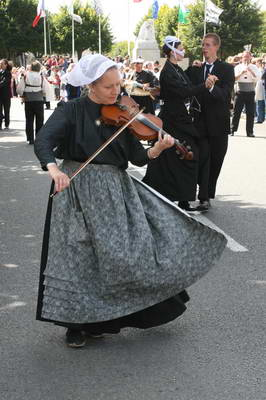 Gabrielle, in traditional costume, playing her violin